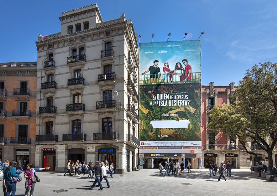 lona-publicitaria-barcelona-puerta-del-angel-netflix-dia-vsa-comunicacion